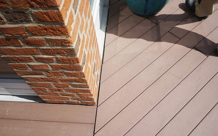 Installing-Composite-Decking-695x435 Blog